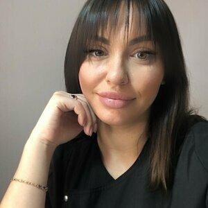 Ника Попова